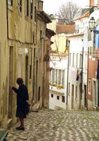 I'm trying to open the door while looking somewhere else. Alfama, Lisbon, Portugal