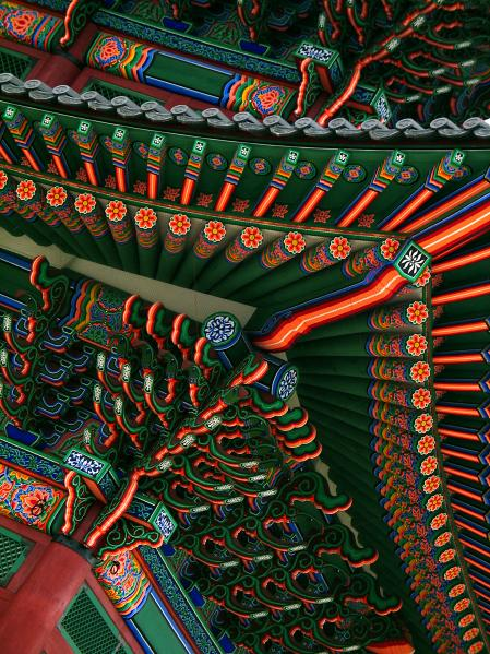 Gyeongbokgung Palace, main building details of painted beams and ornate roof tiles. Seoul, Korea