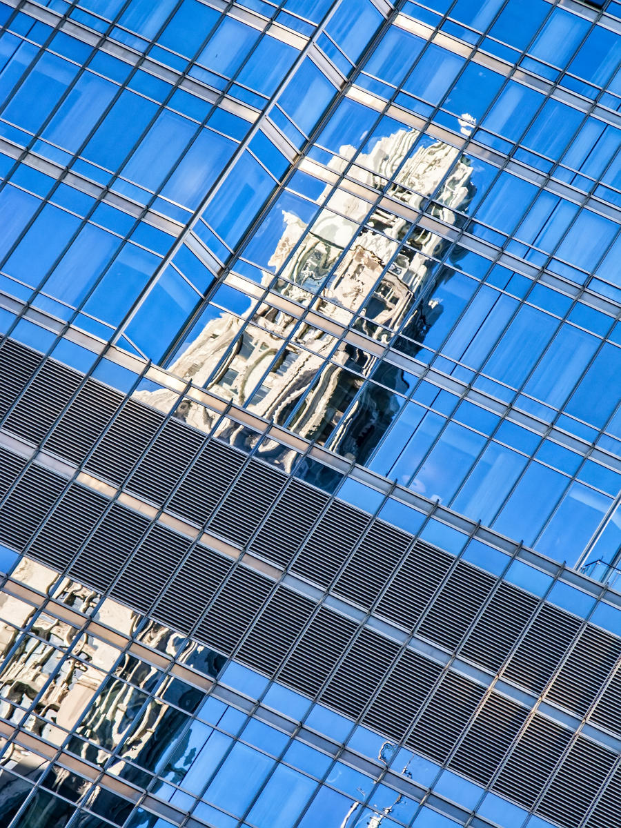 Wrigley Building reflected on Trump Tower